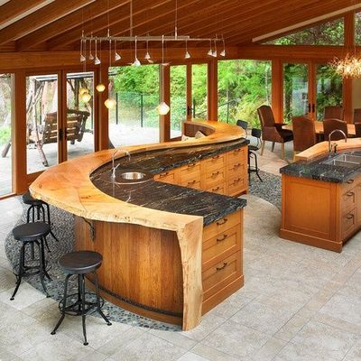Massive S-shaped kitchen island with built-in banquet