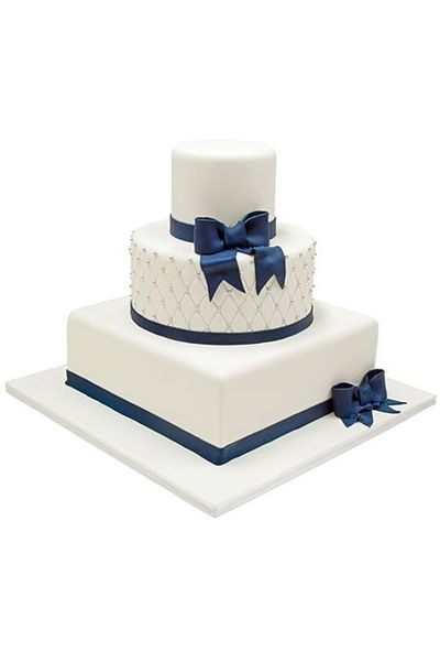 White fondant wedding cake with square and round tiers, deco ...