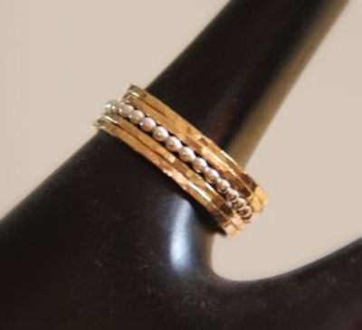 Set of 5: 4 stacking rings in 14k gold filled and 1 beaded, dotted stack ring in sterling silver