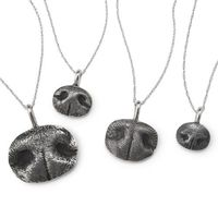 Custom Pet Nose Print Necklacesicon are gorgeous and handmade sterling silver pendants cast from your dog's unique little nose.