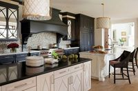 Traditional kitchen with black top island and cabinets