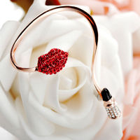 This fine wrap around earring displays a sexy rhinestone decorated lip design that are bright and red with a detachable lipstic stud. Designed as a single ear wrap for left ear only,the lip ear wrap earring is in your choice of gold and rose gold.