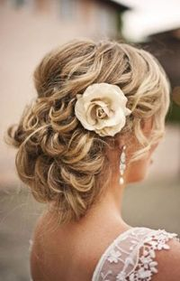 coiled up-do + cream flower accessory
