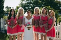 Pink bridesmaid dresses trimmed with lace + astilbe bouquets.