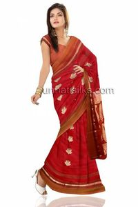 Look sensuous and glamorous with this beautifully woven mesmerizing red color south handloom silk saree. This is saree has got all over silver color zari border along pattu floral design mango booties and zari lines pallu saree which is perfect for weddi...
