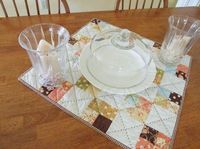 Something I just love about this simple Tapestry table topper.