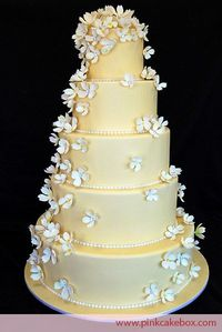 pale butter yellow fondant and white dogwood sugar blossoms | wedding cake