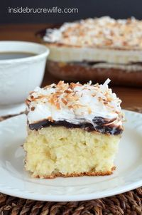Coconut Fudge Poke Cake - easy cake topped with fudge, Cool Whip, and coconut