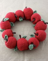 By affixing eleven of these adorable little fruits to a yarn-covered base, you've made an impressive autumn display!