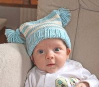 Free easy knitting pattern for a Baby Tassels Hat