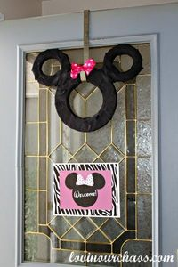 Minnie Mouse Door Wreath - wrap styrofoam or green floral foam with black ribbon or crepe paper streamers. Add a bow and you have an inexpensive and festive birthday wreath !