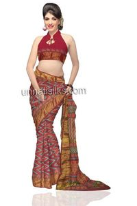 Blissful maroon handloom vegetable dyed Maheshwari pure sico sari with matching blouse. This sari has got all over peach-orange and Egyptian blue colored temple style napthol block prints along with abstract print border and naksi woven maroon borders on ...