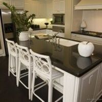 Kitchen-white cabinets and white subway tile, black counter - i want to paint cabinets white. not sure how it will look...