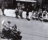 Walt Disney drives down Main St. on opening day