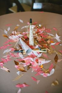 Noisemakers, pink and gold confetti topped tables