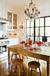 I love the chic chandelier over the rustic farmhouse table.