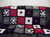 http://www.artfire.com/uploads/product/0/610/24610/2124610/2124610/large/red white and black- granny square afghan 138802fc.jpg