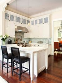 Expanded Outlook- This is definitely a kitchen I would love to have in my dream home. I love the blue backsplash and marble counter tops. The sink is divine. All the detail is just perfect. I also like that it is not a huge space but that a couple of peop...