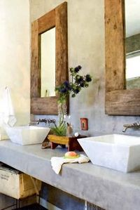 concrete counters / stone basins / reclaimed wood mirrors