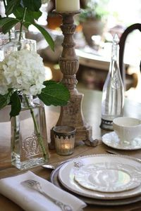 eclectic bottles and candleholders as accents