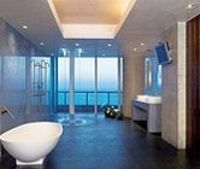 A rain module and stand alone tub are the perfect venues for relaxation in this ocean view bathroom.
