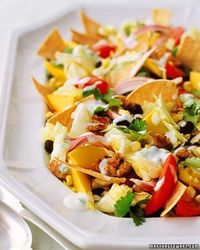 Recipe for Healthy Taco Salad - Taco Salad is a delicious and thoroughly satisfying meal. Ground turkey stands in for beef; nonfat yogurt laced with lime juice, jalapeno, and cilantro makes a creamy dressing.