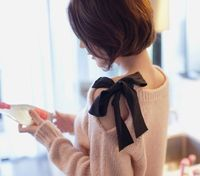 """Try this. Take an old sweater. Cut a slit in along the shoulder down about 7"". Fold over raw edge and sew in place. Sew a piece of ribbon about 15"" long to one side of neckline and another ribbon to the other side of the neckline. Tie togethe..."