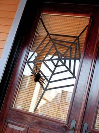 Turn a front door window into a spider's clever trap with black crafts tape. Start with three long strips of tape, creating an off-center X shape with two pieces and using the third to cut across the middle of the X, dividing your glass window into si...