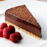This chocolate tart recipe from Dominic Chapman is simple and yields brilliant results. Chocolate flavors combine with oranges and hazelnut