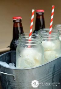 Root beer float bar - bottles of root beer and scoops of ice cream in mason jars on ice. Great party idea!