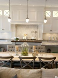 Alice Lane Home - Beautiful open plan kitchen dining room with white subway tiled backsplash with carrara marble diamond tile over stovetop