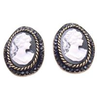 Earrings features a delicate carved portrait of a lady Vintage Beautiful new inspired Cameo jewelry versatile stunning Cameo earrings in Oval Shaped with Lady Cameo carved with artistic work around the frame with jet Crystals embedded all over that enhanc...