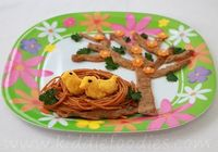 Birds in a nest meal for kids. Two cute yellow birds in their nest under a tree will cheer up little faces! Delicious and healthy recipe for kids: veal, pasta, cauliflower and cheese.