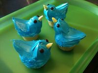 Blue Bird Cupcakes...so cute! make the body by frosting a cupcake and then attaching a donut hole and half of a marshmallow cut on the diagonal. Place the two parts opposite each other on the cupcake. Place the cupcake in the freezer until firm, about 15 ...