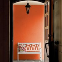 """Pittsburgh Paints' Orange Vermillion is a great choice in a foyer or mudroom, where """"big colors"""" can raise the temperature and draw the eye away from clutter.