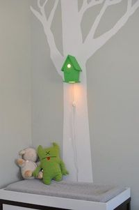 Birdhouse night light. Cute, however I would not let the cord hang so close to changing table.
