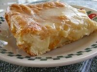 Christmas Morning... Cheese Danish - Ingredients: 2 cans ready to use refrigerated crescent rolls 2 8-ounce packages cream cheese 1 cup sugar 1 teaspoon vanilla extract 1 egg 1 egg white Glaze: 1/2 cup powdered sugar 2 Tablespoons milk 1/2 teaspoon vanill...