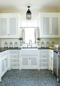 Pebble mosaic tile floor and two tone cabinets