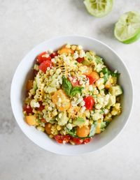 Grilled corn tomato salad with blue cheese + basil