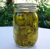 Easy refrigerator pickled jalapenos--keep in the fridge for months.