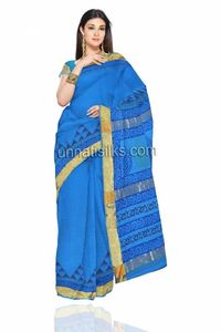 Dazzle with a mixed bag of the entire thing. Romantic and Rebellious Play up the soft mood of pastels and sheers with this scintillating blue color handloom Kota cotton saree. This Kota cotton sari has got all over plain along with black color temple st...