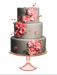 Grey wedding cake with pink and gold flowers